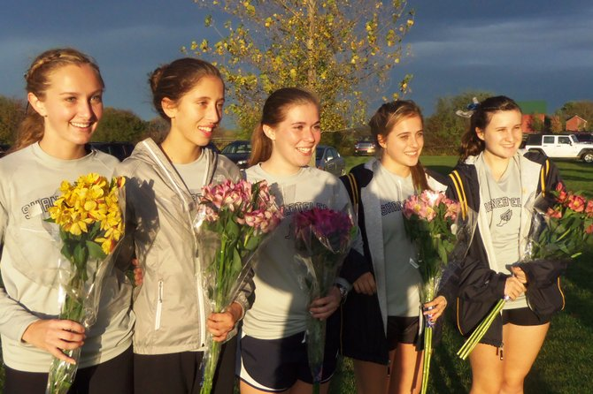 It was the final goodbye for the seniors on the Skaneateles girls cross country team after their 15-50, league-clinching win at the Polo Grounds over Jordan-Elbridge on Wednesday afternoon. Honored were, from left: Madeline Adams, Morel Malcolm, Maria Schillace, Alex Clark and Virginia Hamlin.