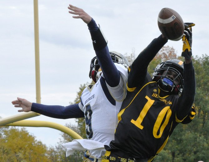 West Genesee defensive back Bailey Gauthier (9) breaks up a pass intended for Henninger's Keisean Scott in Saturday's game. Scott did catch three touchdown passes - of 84, 64 and 24 yards - as the Wildcats lost, 27-21, to the Black Knights.