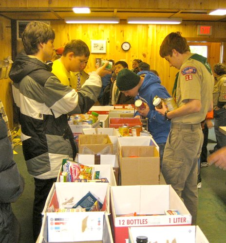 Cazenovia-area scouts arrange donated food from the 2012 food drive.