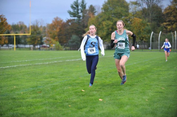 Marcellus girls cross country runner Rachel Garn (right) sprints to the finish line just in front of Skaneateles' Kaitlyn Neal in Wednesday's OHSL Liberty division championship meet at Jordan-Elbridge. Garn, in a time of 20:07.3, beat Neal by two-tenths of a second.