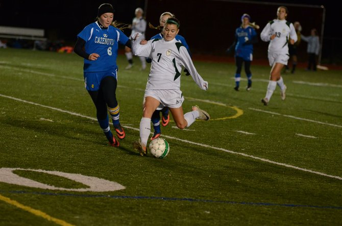 Marcellus midfielder Brielle Filtch (7) winds up for a long kick, chased by Cazenovia's Clare Costello (6), in last Thursday's Section III Class B quarterfinal, where Filtch's two goals helped produce a 4-0 Mustangs shutout of the Lakers.