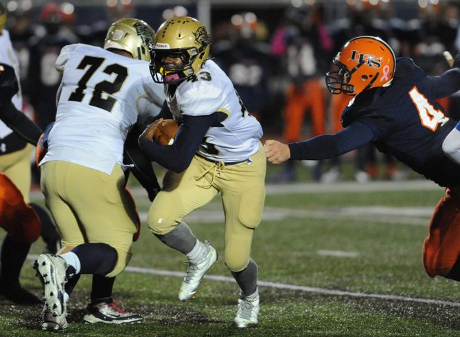 West Genesee senior tailback Naes Howard (43), blocked by E.J. Northrop (72), finds some running room past the grasp of Liverpool's Ben Terzini (4) in last Friday's Class AA playoff game, where six turnovers cost the Wildcats in a 28-0 defeat to the Warriors.