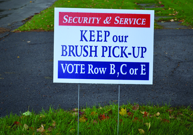 "DeWitt Republican candidates erected around 100 signs last week that call for keeping brush pickup and saving the DeWitt Police. The Democrats say both issues are ""fabricated."""