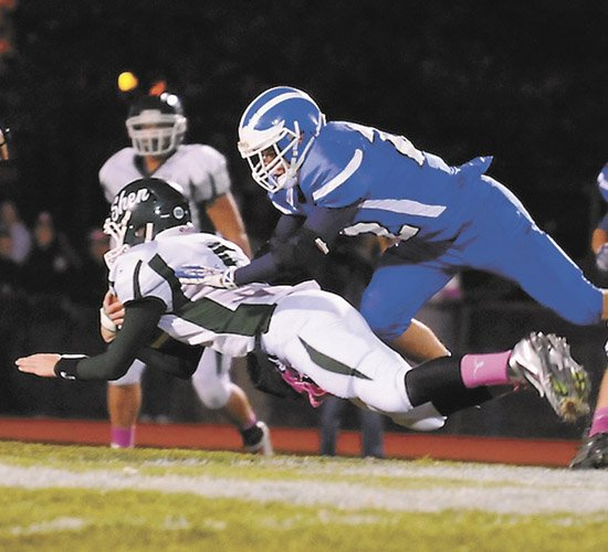 Shaker's Mike Mainella dives to tackle a Shenendehowa player during last Friday's Section II Class AA quarterfinal game in Latham.