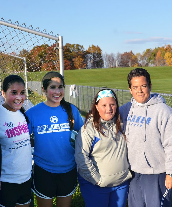 Shaker High School senior, Gianna MacPhee, second from right, was recognized with a standing ovation at Shaker girls varsity soccer senior night. MacPhee, pictured with her two sisters and coach Tara O'Keefe, was the first student with special needs to play a varsity sport at Shaker High School.