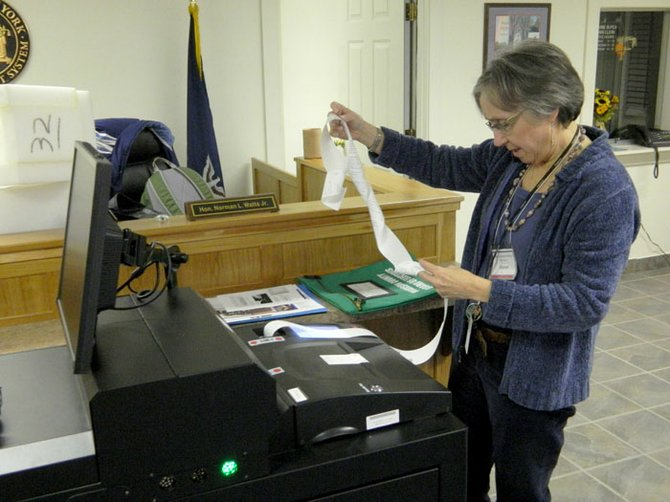Fenner elections inspector Sharon Schmit prints out the final vote tally at the Fenner town office, which was also Tuesday's town polling place. The election winners may come down to the absentee ballots, since the town supervisor candidates are separated only by 9 votes, and one of the town board seats is separated by only eight votes.