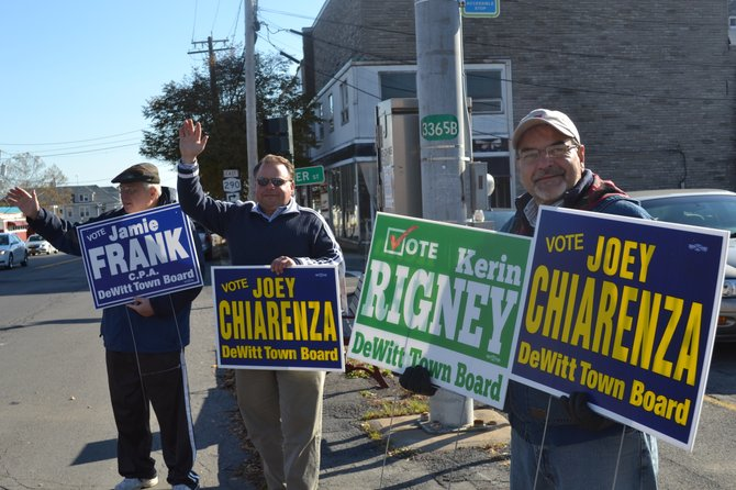 Town councilor Jack Dooling, newly-elected councilor Joey Chiarenza and Chuck LaDue, who helped on the campaign, hold signs in East Syracuse on Tuesday morning, Nov. 5. Chiarenza and fellow Democrats Kerin Rigney and Jamie Frank swept the town board elections by a large margin.