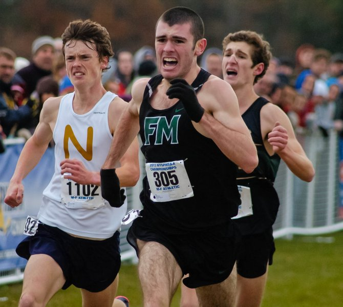 Fayetteville-Manlius boys cross country runner Bryce Millar beats out Northport's Mike Brannigan (left) and Rush-Henrietta's Mickey Burke in last Saturday's state Class A championship race at Queensbury High School. The Hornets also won the boys and girls state Class A team titles.