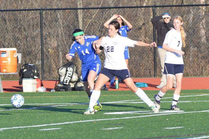 Cicero-North Syracuse senior midfielder Stephanie Liberati (14) finds her path to the ball blocked by Massapequa's Nicole Mahin (22) in Saturday's state Class AA semifinal at Cortland High School. Liberati and the Northstars lost, 4-1, to the Chiefs.