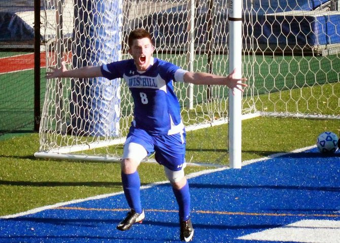 Westhill senior forward Barak BenYehuda (8) celebrates one of his two goals in Saturday's 2-1 victory over Livonia in the state Class B semifinals. Those goals helped the Warriors erase a 1-0 deficit and advance to Sunday's title game against Carle Place.