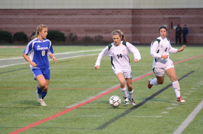 Marcellus senior midfielder Abigail Fallon (14) moves in front of teammate Alana Montreal (4) and dribbles past Oneonta's Abigail Picinich in Sunday's state Class A final, where a last-minute goal helped the Yellowjackets defeat the Mustangs 2-1.