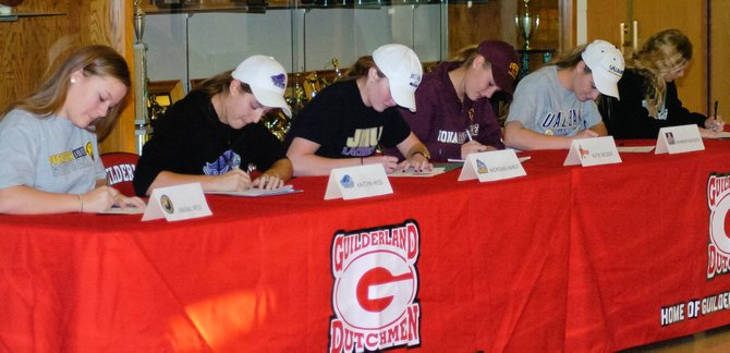 Five Guilderland girls lacrosse players and one softball player sign their national letters of intent at a Nov. 14 ceremony at the high school. The seniors are, from left, softball player Abi Peck (Pfeiffer) and girls lacrosse players Kaitlyn Hess (Stonehill), Morgan Hardt (James Madison), Katie Becker (Iona), Shannon Mackesey (University at Albany) and Brittney Pulliam (University of Tampa).