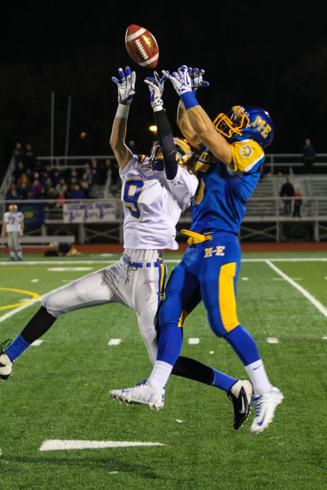 Cazenovia defensive back Keaton Ackermann (9) breaks up a pass intended for Maine-Endwell's Adam Gallagher (5) during Saturday night's Class B regional final. Ackermann would get a fourth-quarter interception and make all four of his extra-point attempts in the Lakers' 35-34 defeat to the Spartans.
