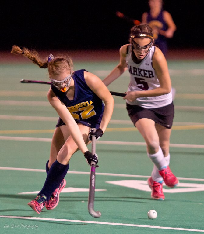 Cazenovia midfielder Ashley Kent (20) works the ball down the field past a Barker defender in Saturday night's state Class C semifinal. Kent's goal in the second overtime period gave the Lakers a 1-0 victory and a spot in Sunday's final against Pierson/Bridgehampton.