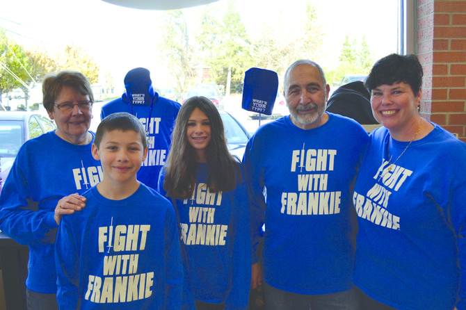 The entire Palladino family is backing the effort to 'Fight with Frankie' by selling blue merchandise at Dazzle in Manlius. The village put up blue lights around the swan pond and the gazebo by St. Ann's church to raise awareness.