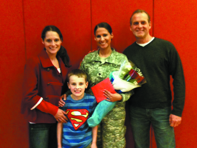The Scannell family, from left: Breanna Scannell, Ayden Scannell, SPC Erin Scannell and Kevin Scannell.