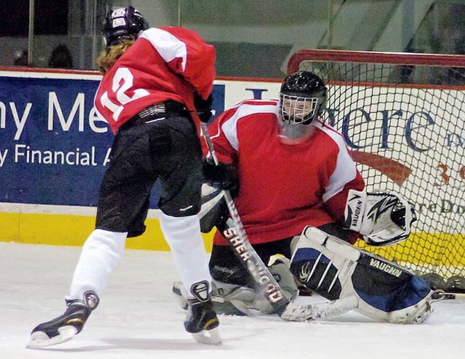 Guilderland/Mohonasen/Scotia-Glenville goaltender Tim Brisley, right, makes a save during last Thursday's practice at Union College. Brisley is the only goalie on a 12-player roster for the Storm.