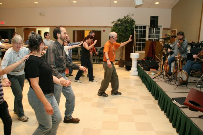 Paul Rosenberg, in orange, is pictured leading a dance in 2010 during the kickoff for a different community dance series at a Delmar church.