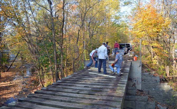 Volunteers work on renovations to the bridge over Vly Creek in Voorheesville along the Albany County Rail Trail. The work was recently completed as part of an effort to open a new three-mile portion of the Rail Trail.