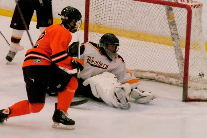 Bethlehem's Andrew Carroll scores 12 seconds into the second period in Saturday's Capital District High School Hockey League game against Christian Brothers Academy at the Albany County Hockey Facility.