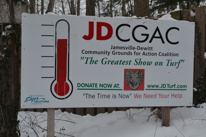 This sign, put up by the Jamesville-DeWitt Community Grounds for Action Coalition, shows how close the group is to its original $1.8 million goal. On Dec. 16, the J-D School Board voted to move forward with a turf field.