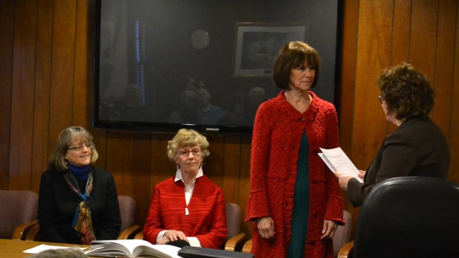 From left: Connie Brace and Mary Sennett look on as Claire Robinson Howard takes the oath of office from Sue Byrne.
