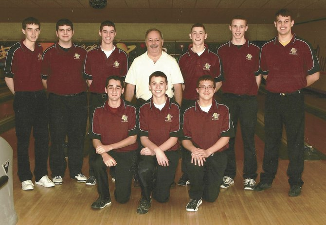 The members of the 2013 state champion Colonie boys bowling team are, from left, (front) Ricky Rovelli, Noah Burke and Nick Peckowitz; and (back) Eric Kaminski, Justin Frey, C.J. Leisenfelder, coach Bill Carl, Justin Carl, Nick Shaw and Charles Moeske.