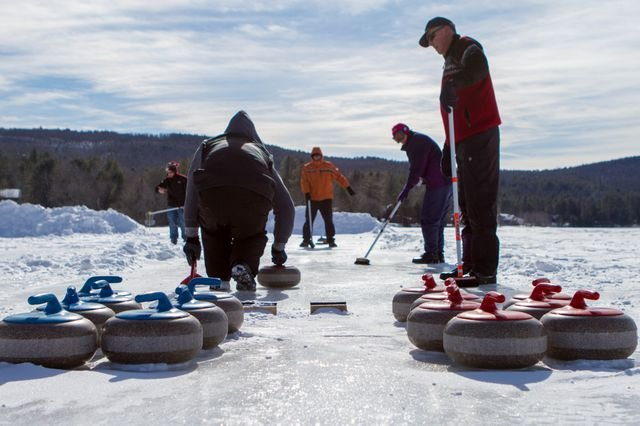 Participants in the 2013 Brant Lake Winter Carnival try their hand at the sport of curling. In its debut year, the Winter Carnival featured outhouse races, snowshoe softball, broomball and flag hockey competition, snow-sculpting, Frisbee golf, an ice-fishing tournament, ice bowling and an expo of vintage snowmobiles. Remarkably popular in its debut year, plans are proceeding for the 2014 edition, set for Feb. 8. Organized by the Tri-Lakes Business Alliance, the event attracted more than 400 people.<br /><br /> Photo by Brandon Himoff