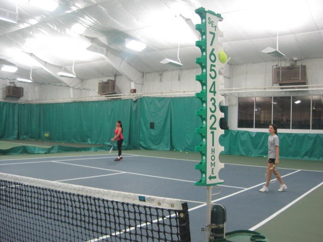 Shannon Mukerji, right, teaches tennis to at-risk youth as a part of Project Safe.
