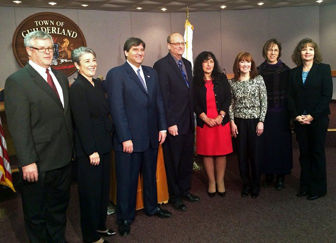From left, Town Justices Richard Sherwood and Denise Randall, Councilman Paul Pastore, Supervisor Ken Runion, Councilwoman Patricia Slavick and Town Clerk Jean Cataldo, Sen. Cecilia Tkaczyk and Receiver of Taxes Lynne Buchanan were sworn in at Guilderland Town Hall on New Year's Eve. Tkaczyk joined local lawmakers for the ceremony.