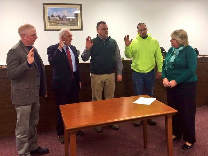 From left, Councilman Douglas LaGrange, Town Supervisor Tom Dolin, Councilman Daniel Mackay and Highway Superintendent Ken Guyer are sworn in by reelected Town Clerk Diane Deschenes at New Scotland Town Hall on Thursday, Jan. 2.