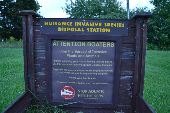An invasive species disposal station at the state boat launch for Skaneateles Lake located off of Route 41A. Proposed new regulations would require all boaters to follow the instructions at these stations.