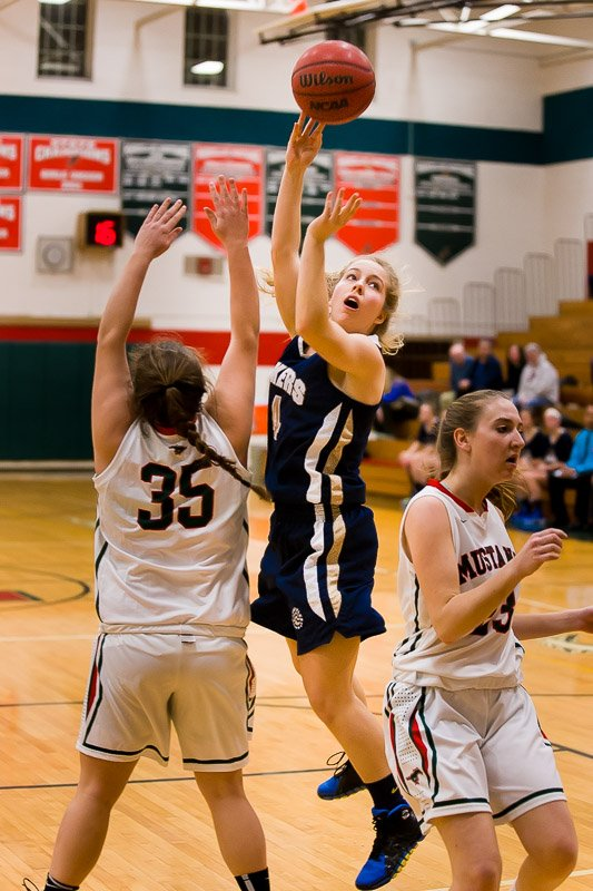 Skaneateles junior guard Elizabeth Lane (4) takes a shot over Marcellus' Shelby Nye (35) in Wednesday night's game. Lane had 24 points, nine assists and six steals as the Lakers beat the Mustangs 75-58 and earned its ninth consecutive victory.