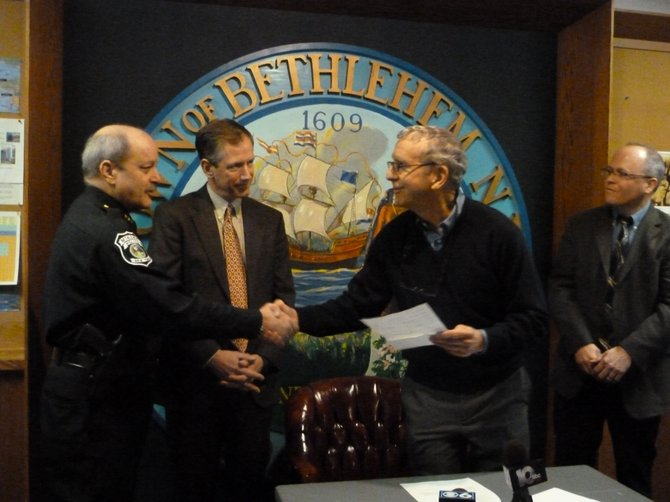 Former Callanan employee Andy Stokes and Project Manager for Callanan Industries Peter Zeh present a donation of land to Bethlehem Town Supervisor John and Police Chief Louis Corsi. .
