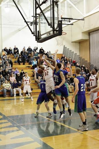 Cicero-North Syracuse forward Ronnie Williams (32) blocks a shot attempt by Liverpool's Bobby King in Tuesday night's game. The Northstars prevailed 65-62 in overtime, avenging a Dec. 10 defeat to the Warriors, as Williams earned 10 points and seven rebounds.