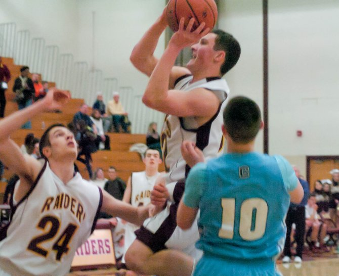 Colonie's Nolan Smith drives to the hoop through traffic during Friday's Suburban Council South Division game against Columbia.
