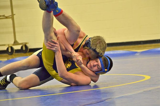 Skaneateles 126-pound wrestler Matt Goetzmann earns a third-period pin over Cato-Meridian's Dakota Green in last Thursday's meet. The Lakers went on to defeat the Blue Devils 57-18 and then win its own dual meet two days later, stopping Auburn 42-29 in the championship round.