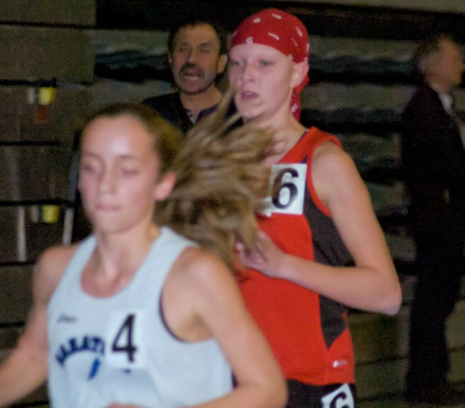 Guilderland's Jenna Robinson applies pressure on one of Saratoga's top three runners in the latter stages of the girls 3,000-meter race at Saturday's Suburban Council Indoor Track and Field Championships at the University at Albany.