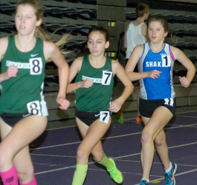 Shaker's Payton Czupil, right, runs with the leaders early in the girls 3,000-meter race at Saturday's Suburban Council Indoor Track and Field Championships at the University at Albany. Czupil finished seventh with a time of 11:09.14.