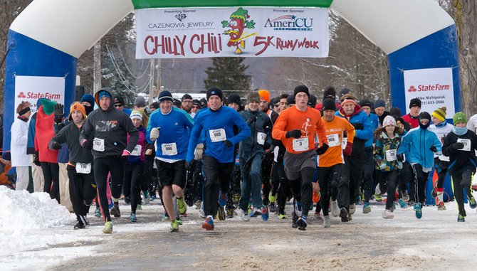 Nearly 900 runners take off at the start of the 10th annual Chilly Chili 5K Run/Walk on Sunday, Jan. 26.