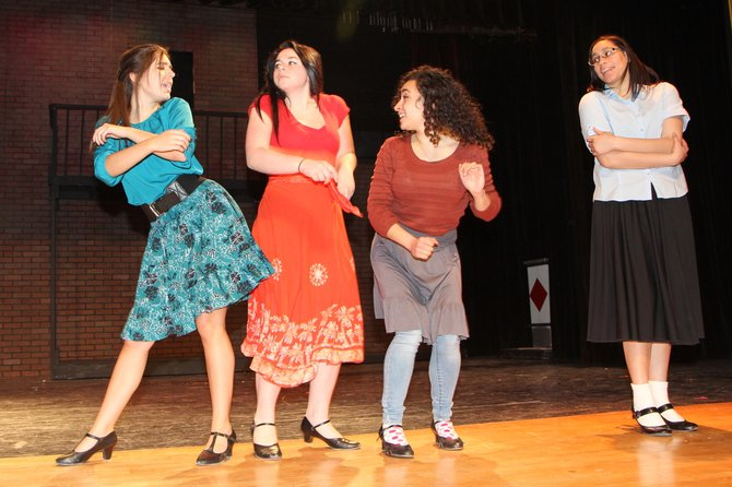"Performing the song ""America"" are the Shark girls from ESM's cast of ""West Side Story,"" that will be performed Feb. 6 through 8 at ESM Central High School."