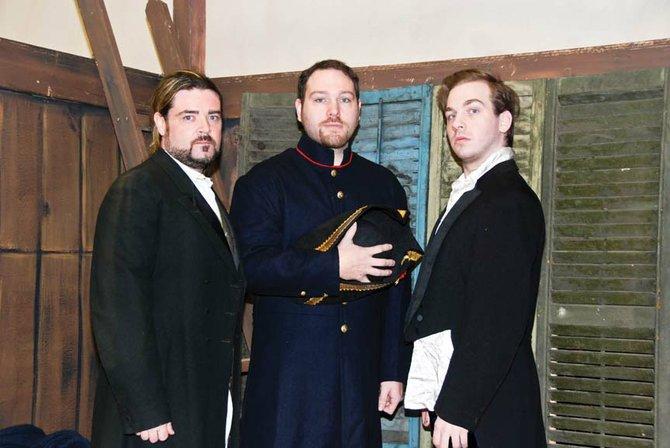 Pictured from left: Henry Wilson (Jean Valjean), Jason Bean (Inspector Javert), Liam Fitzpatrick (Marius).