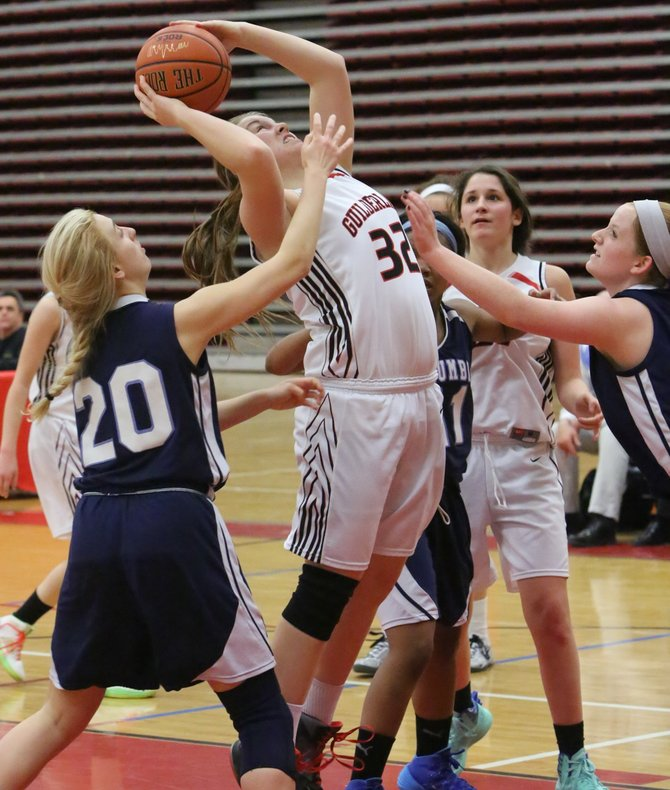 Guilderland's Nicole Fyvie shoots between Columbia defenders during a Jan. 31 Suburban Council South Division game.