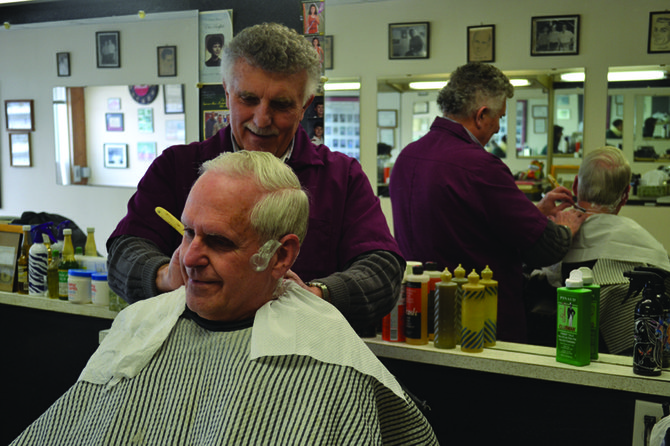 Rocky DiFlorio's barbershop is the last of its kind in the eastern suburbs. Customers are treated to the full barbershop experience, including a straight razor shave. In the chair is Bruce McMorris, of Cazenovia, who has been coming to Rocky's since his barber retired more than 10 years ago.