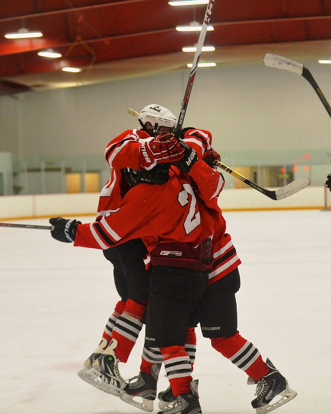 Baldwinsville hockey players celebrate Luke McCaffrey's goal in overtime that helped the Bees defeat the Hornets 2-1 last Friday night at Cicero Twin Rinks. It was the Bees' third victory in a row.