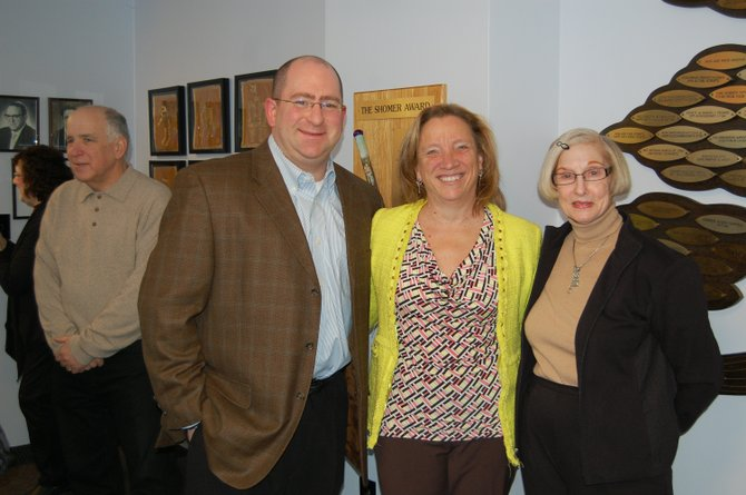 Jeff Scheer, Menorah Park of CNY board president, Mary Ellen Bloodgood, Menorah Park CEO and Sally Ullman celebrate the opening of the Temple Beth El Community Room on Feb. 16.