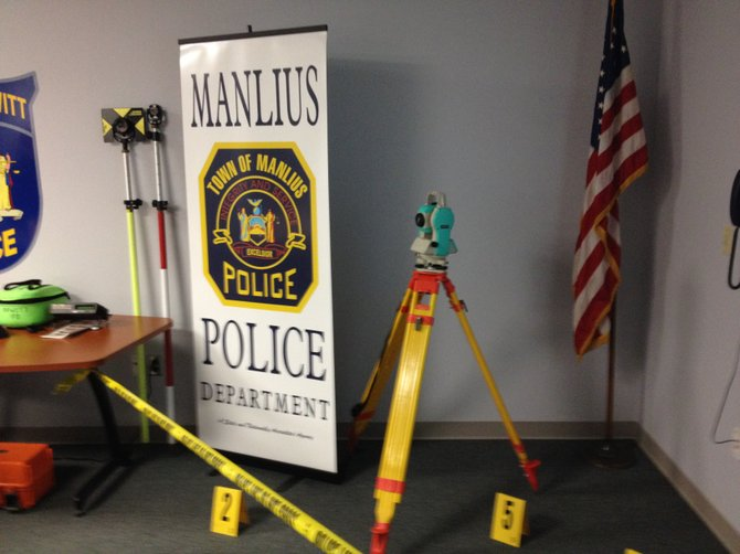 In an effort to cut costs and being the best service possible to residents, the Manlius and DeWitt Police will be sharing personnel and equipment like this laser measuring device, which is used to determine the cause of serious accidents.