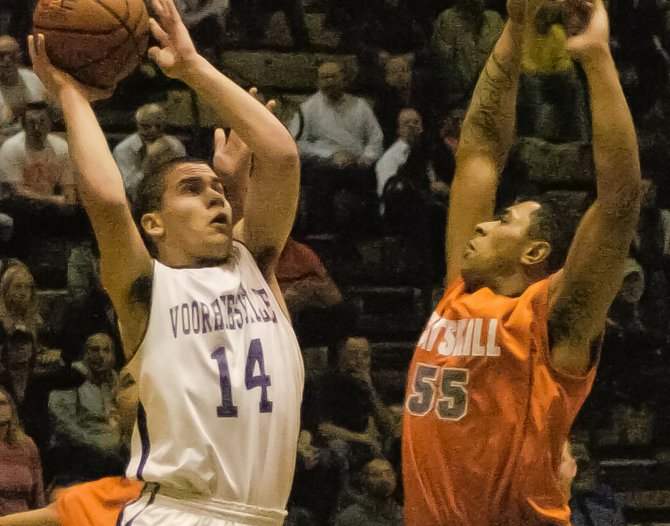 Voorheesville's Shane Parry shoots over Catskill's Shaquille Sims during the second quarter of Friday's Section II Class B quarterfinal game at Hudson Valley Community College.
