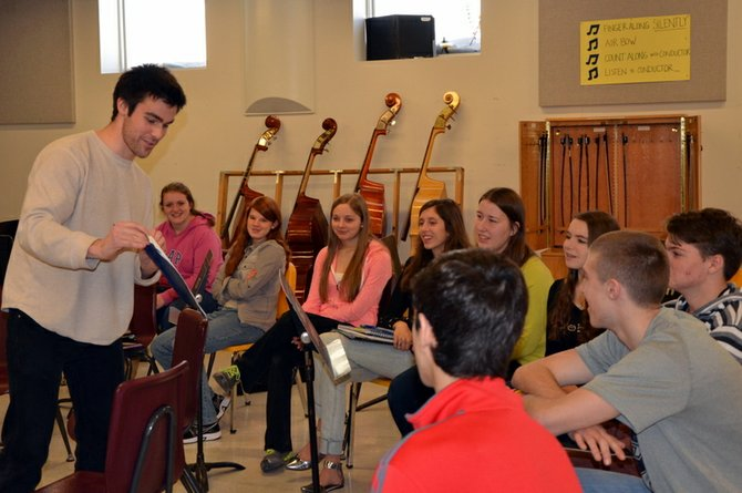 RIGHT: Shane Aaserud shows music students his calendar to illustrate what life is like as a musician.