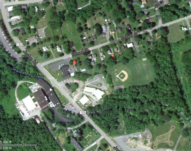 A satellite view of Skaneateles Falls Playground and surrounding area. Though the town board discussed providing better access to the park by adding a sidewalk or acquiring access to the land to the east of the park, they voted to apply for a grant to enhance the playground and basketball.